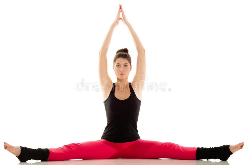 Elastyczna dziewczyna robi rozciągań pilates ćwiczeniu fotografia stock