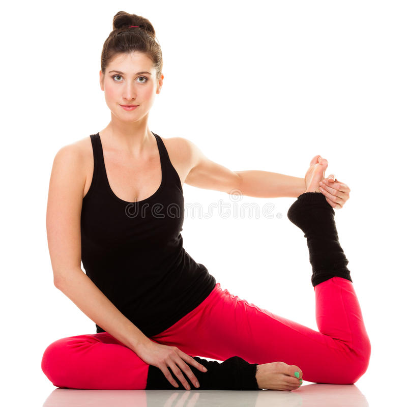 Elastyczna dziewczyna robi rozciągań pilates ćwiczeniu obraz royalty free