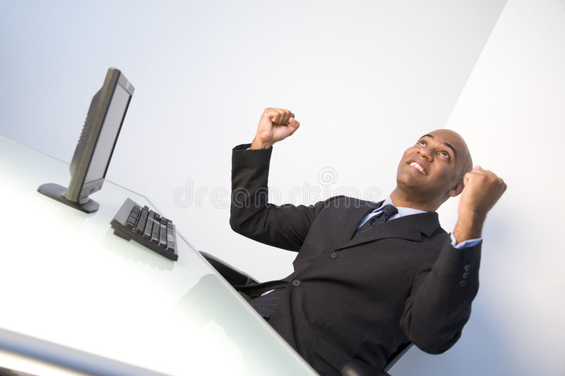 Elated businessman royalty free stock images