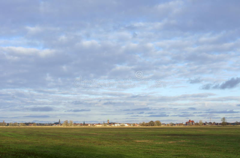 Elbe City Wittenberge. The meadows and wetland landscape on the shores of the river Elbe with the city of Wittenberge in the background royalty free stock photo