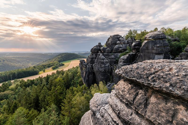 Elbe Sandstone Mountains - Lookout in the evening light. Elbe Sandstone Mountains - View with rocks and wide landscape in the back light, evening light with royalty free stock images