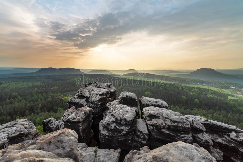 Elbe Sandstone Mountains - Lookout in the evening light. Elbe Sandstone Mountains - panoramic view from the mountain Gohrisch to the west, evening light with royalty free stock photo