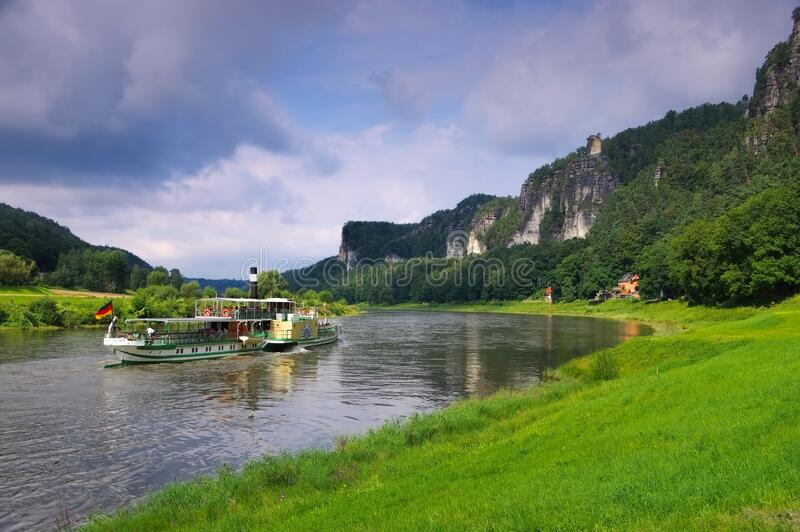 Elbe sandstone mountains, river and ship royalty free stock image