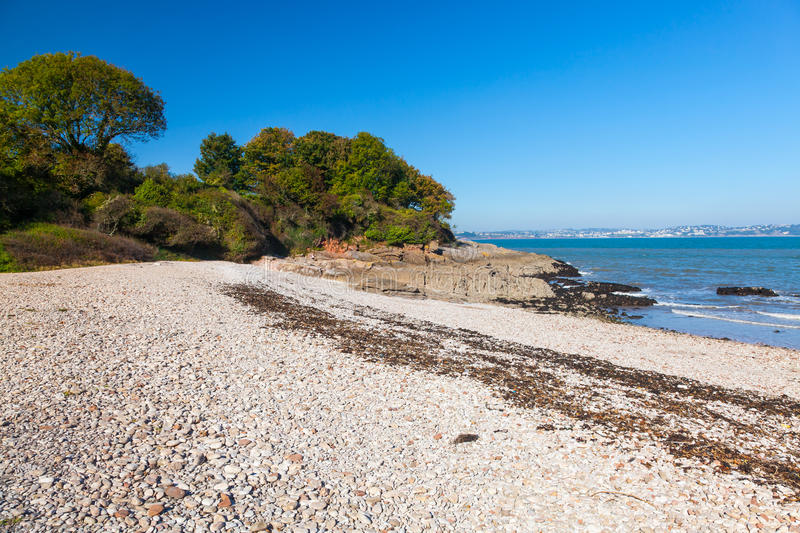 Elberry Cove Brixham Devon. The beautiful shingle beach at Elberry Cove Brixham Devon England UK Europe royalty free stock photography