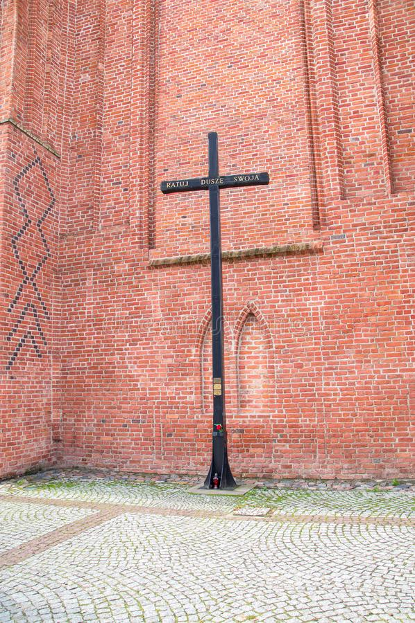 Elblag, Poland - September 9, 2017: Cross next to St. Nicholas Cathedral stock photos