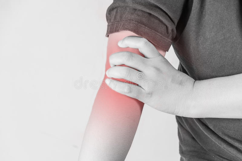 Elbow injury in humans .elbow pain,joint pains people medical, mono tone highlight at elbow royalty free stock photography