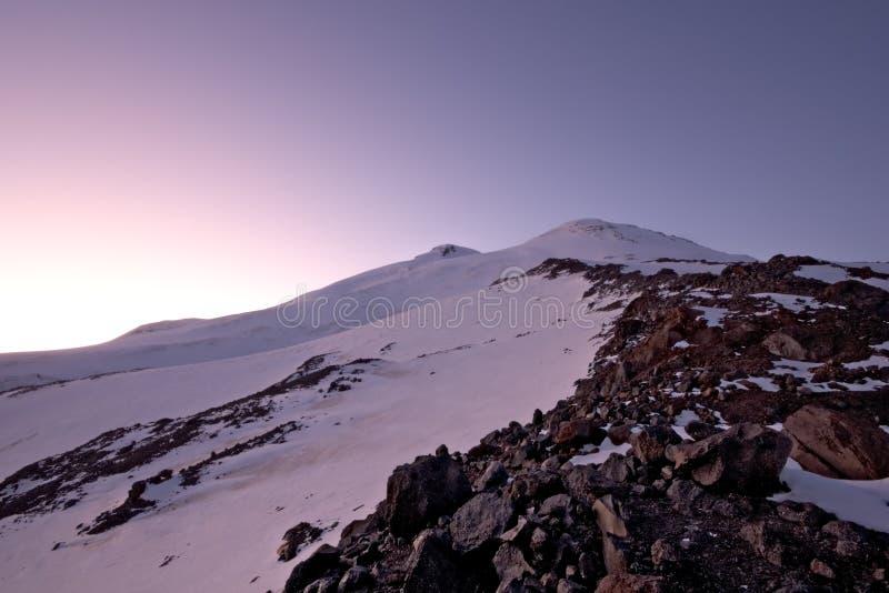 Elbrus highest peak of Europe and Russia in sunset. Elbrus (5642m) - the highest peak of Europe and Russia in sunset. Caucasus mountains. Kabardino-Balkaria royalty free stock images