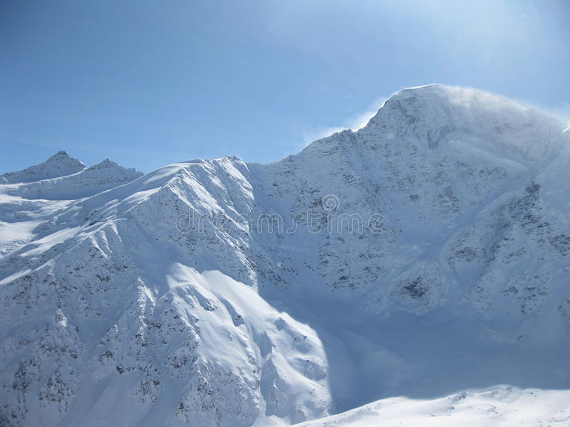 Elbrus mountains view in winter. Snow, wind and cl stock photography
