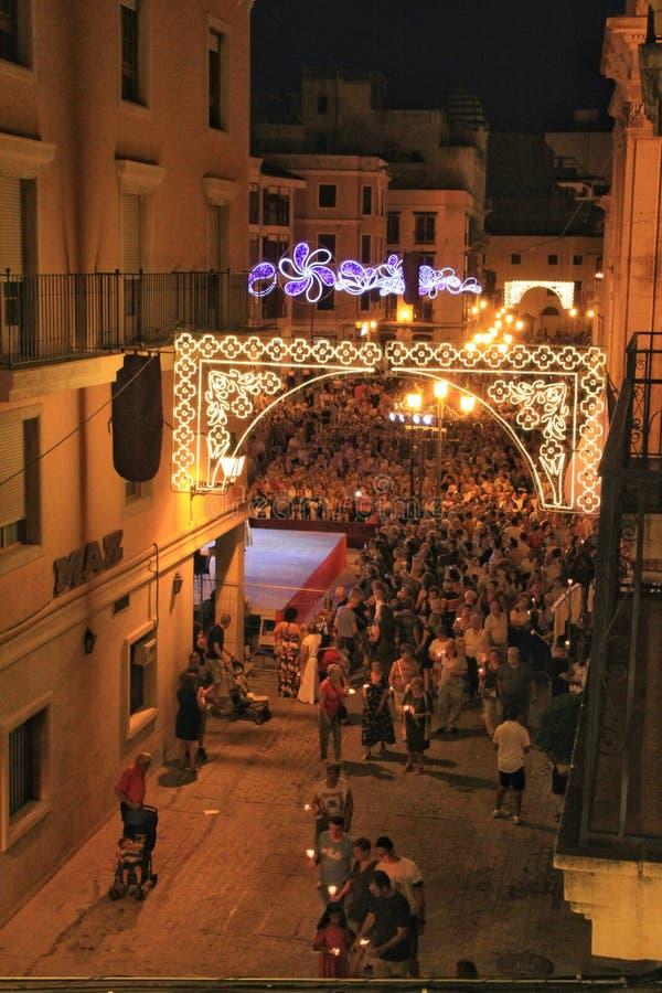 Elche square crowded of people in candle procession on La Roa festivity. Elche, Alicante, Spain- August 14, 2019: Elche square full of people in candle stock photos