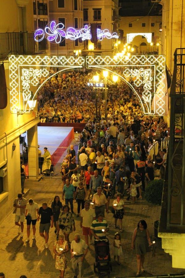 Elche square crowded of people in candle procession on La Roa festivity. Elche, Alicante, Spain- August 14, 2019: Elche square full of people in candle royalty free stock photo