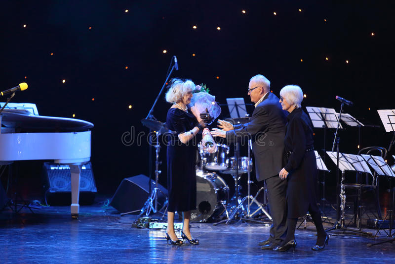 Eldar Ryazanov and wife congratulate Nemolyaeva stock photo