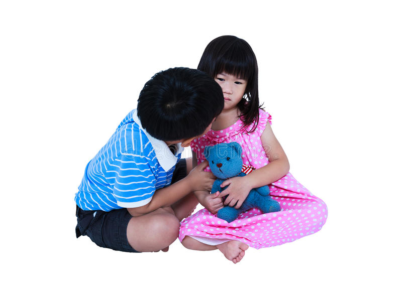 Elder brother reconcile or soothing a crying his sister. Isolate. Full body of elder brother reconcile or soothing a crying his sister. Sad girl sitting with royalty free stock photography