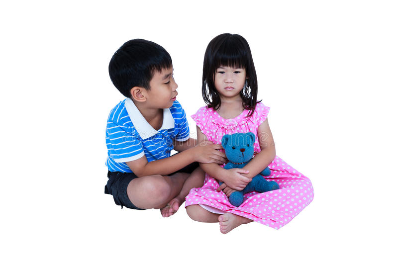 Elder brother reconcile or soothing a crying his sister. Isolate. Full body of elder brother reconcile or soothing a crying his sister. Sad girl sitting with stock image