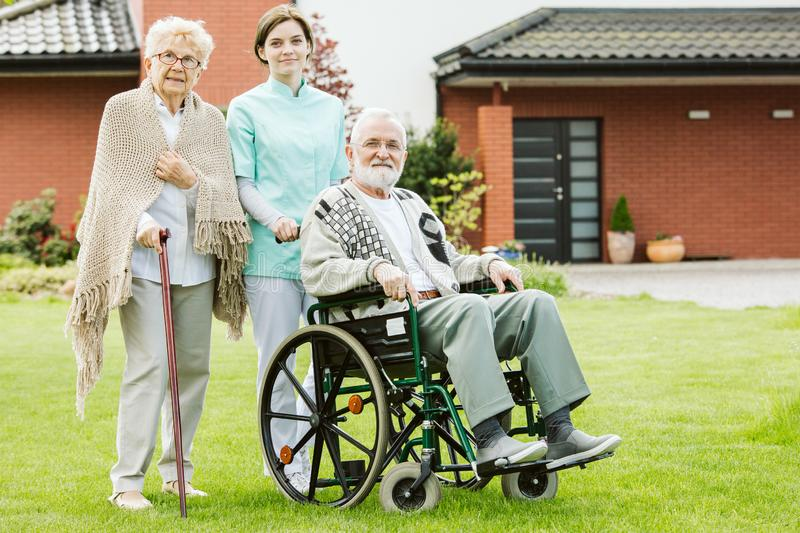 Couple in the nursing house with caregiver. Elder couple in the nursing house with caregiver stock photography