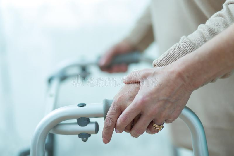 Elder lady with walker. Elder and ill lady has to use walker stock image
