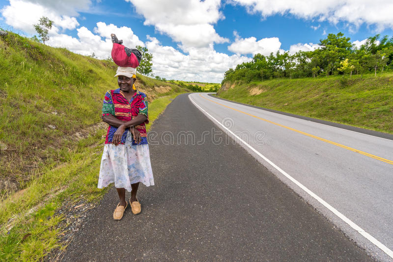 Elder local woman on road, Dominican Republic royalty free stock photo