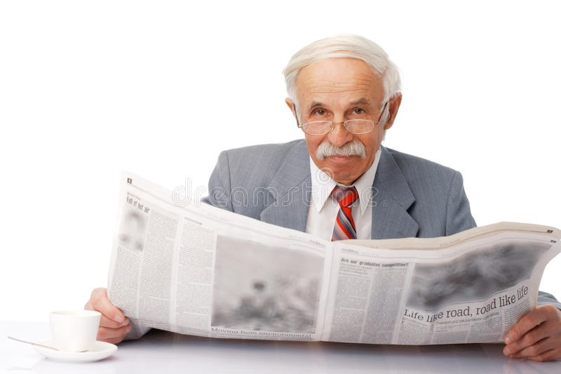 Elder man reading a newspaper stock photo