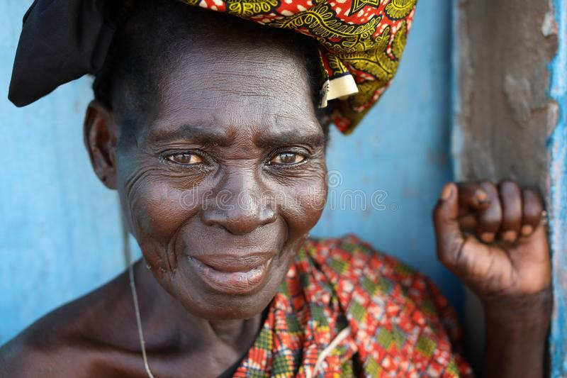 Market woman in Accra, Ghana. An elder market woman with colorful traditional dress in Accra, Ghana stock photography