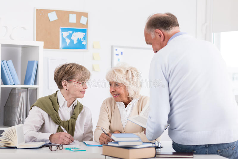 Elder people studying in library royalty free stock photography