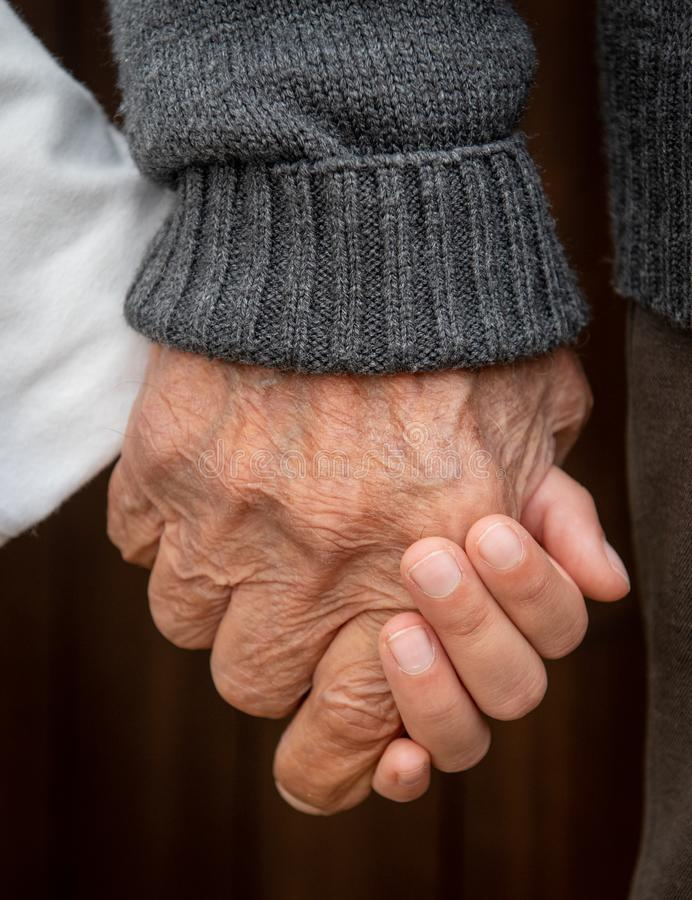 Free Elder Senior Adult And You Child Holding Hands Royalty Free Stock Photos - 163676518