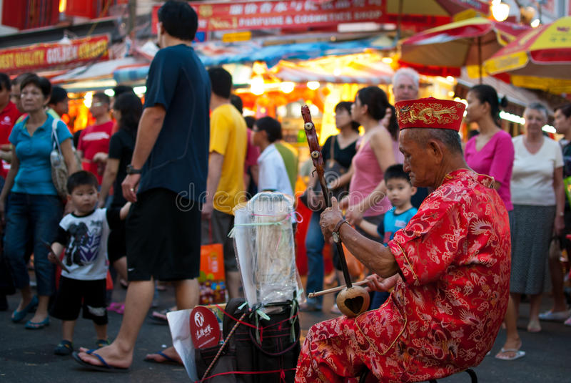 Elder street musician stock images