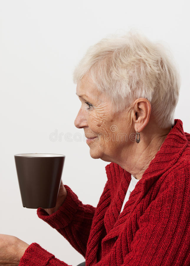 Elder and tea. Elder person drinking tea and smiling stock photos