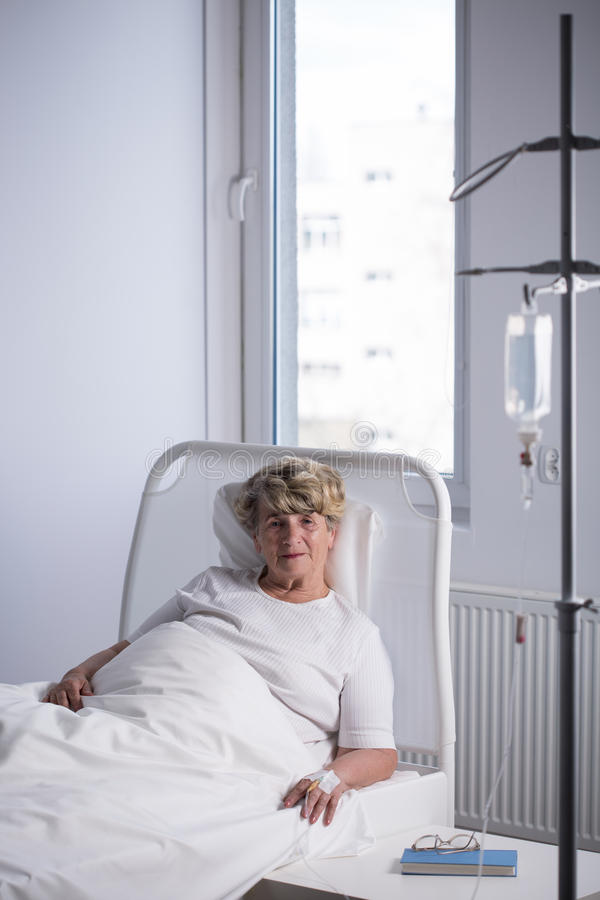 Elder woman on a drip royalty free stock images