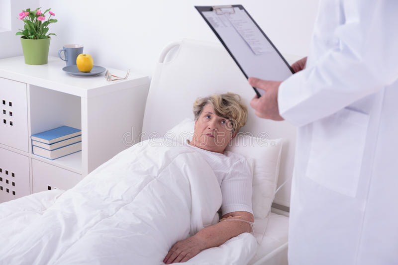 Elder woman in private clinic. Ill elder women lying in private clinic stock photography