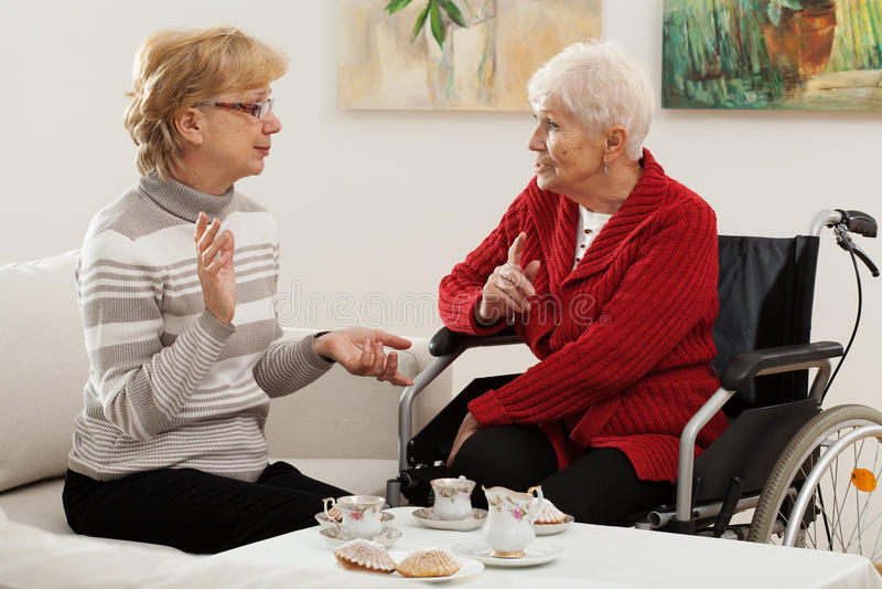 Elder women meeting. Two elder women spending nice time together stock image