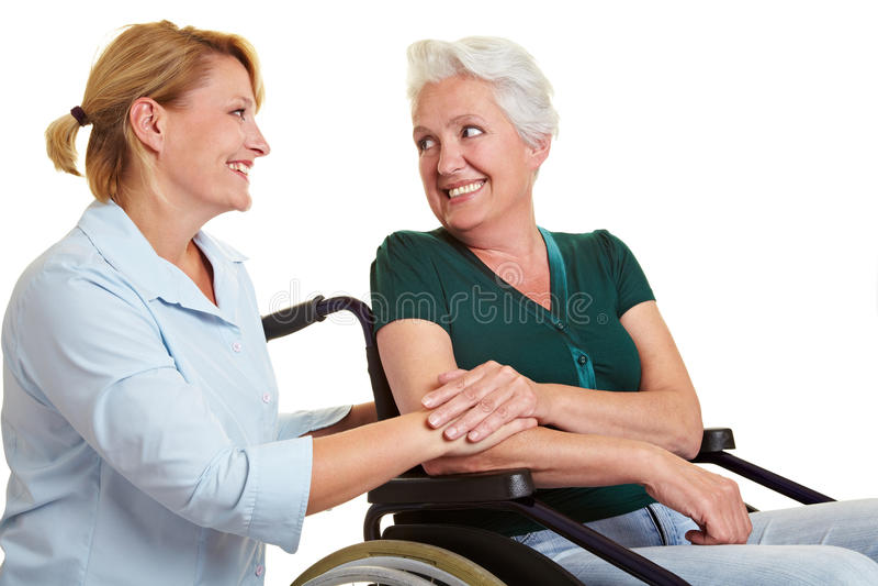 Eldercare voor gehandicapte hogere vrouw stock afbeeldingen