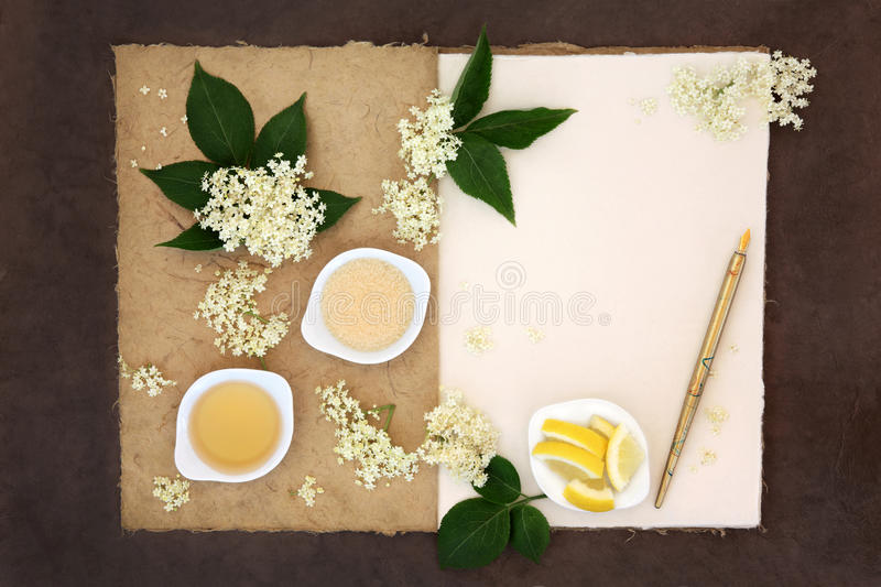 Elderflower Champagne Ingredients. With old pen over natural hemp notebook and lokta paper background royalty free stock photography