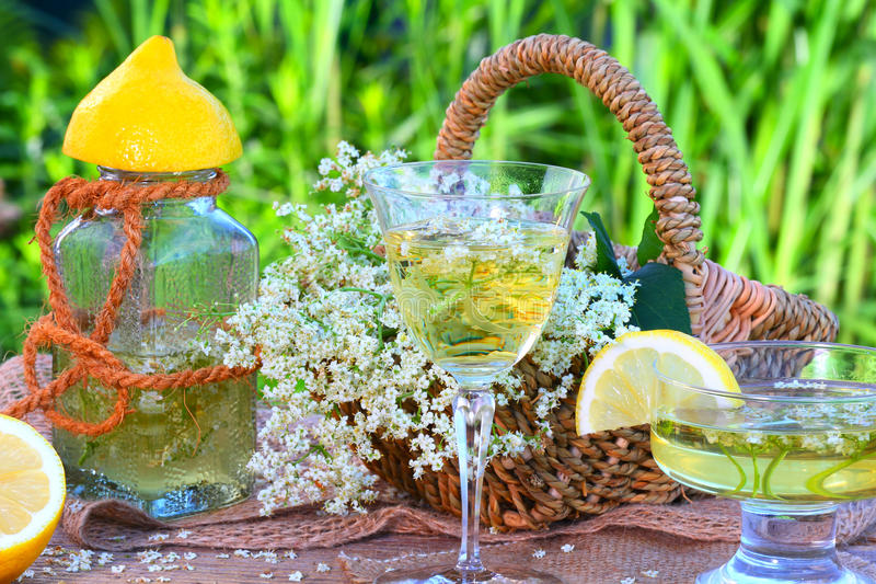 Elderflower drink. WITH LEMON on the garden table royalty free stock images