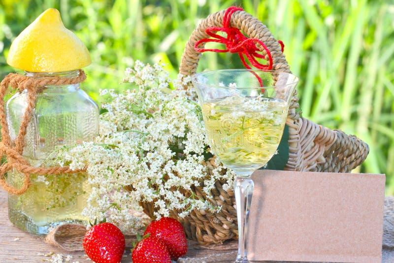 Elderflower drink and strawberries stock images