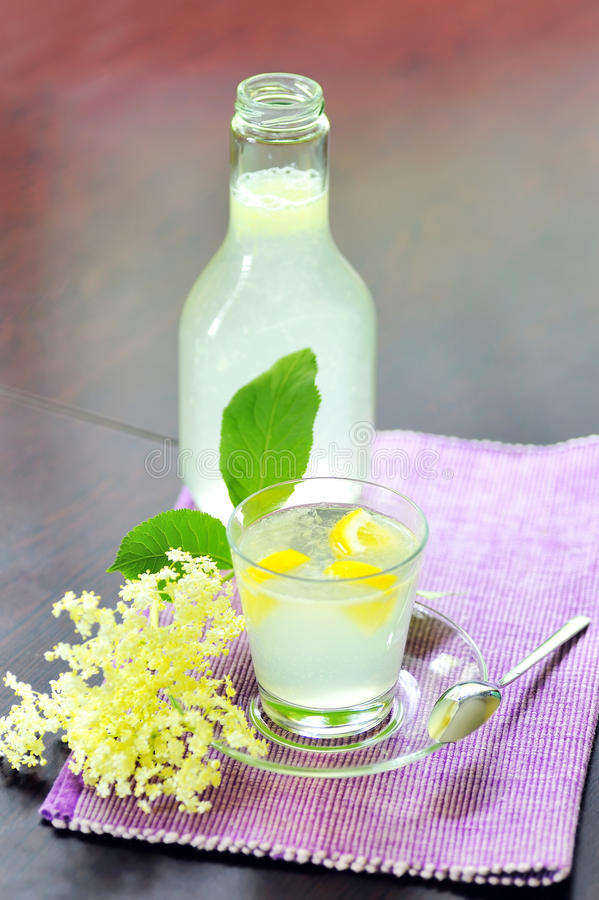 Elderflower juice with lemon. Shoot in studio stock photo