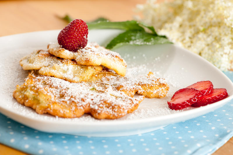 Elderflower Pancakes. With strawberry on a plate stock images