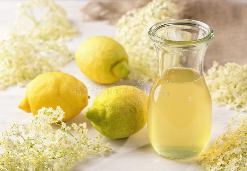 Elderflower syrup. In a glass royalty free stock images