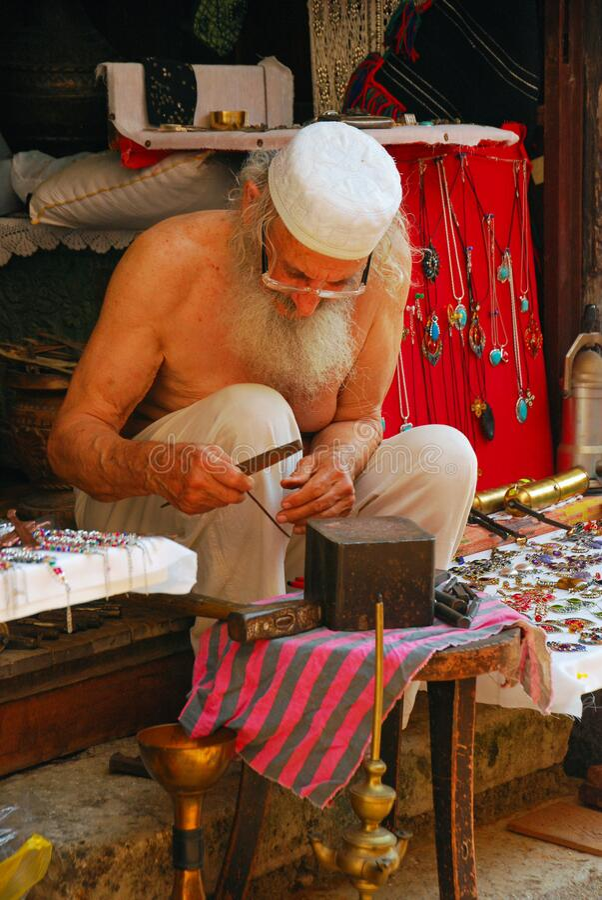An Elderly Artisan Working on Traditional Handmade Ornament. In Mostar Main Tourist Street, Bosnia
