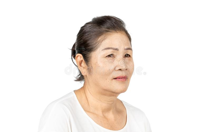Elderly asian woman portrait 60-70 years old on white background stock image