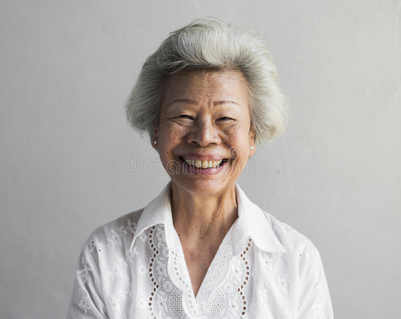 Elderly asian woman smiling face expression portrait stock images