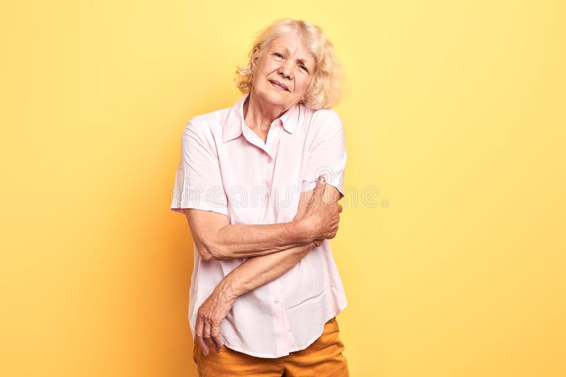 Elderly beautiful woman touches her arm royalty free stock images