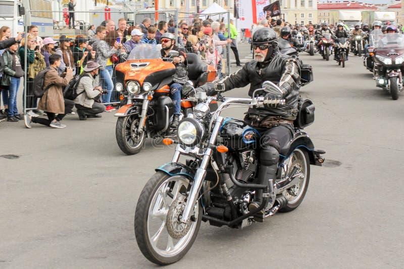 Elderly biker on a motorcycle royalty free stock image