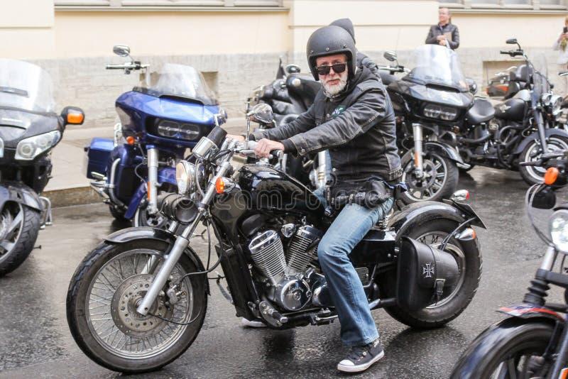 Elderly biker on a motorcycle royalty free stock photo
