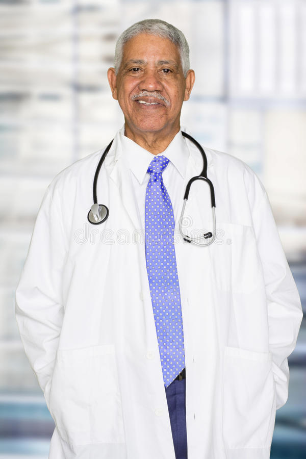 Elderly Black Doctor. Working in a hospital royalty free stock images