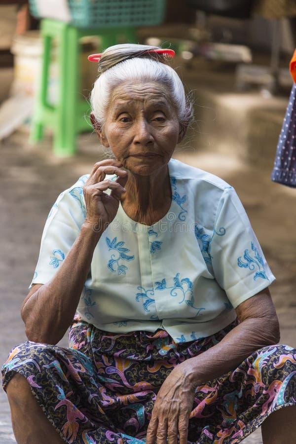 Elderly Burmese Woman - Yangon - Myanmar. An elderly Burmese woman sitting in Bogyoke Market in the city of Yangon (Rangoon) in Myanmar (Burma stock photos