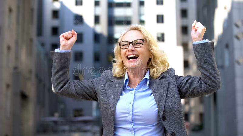 Elderly business lady suit dancing, feeling happy of work success, inspiration royalty free stock photos