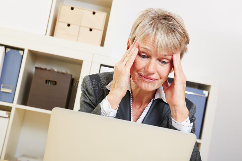 Elderly business woman with burnout royalty free stock photography