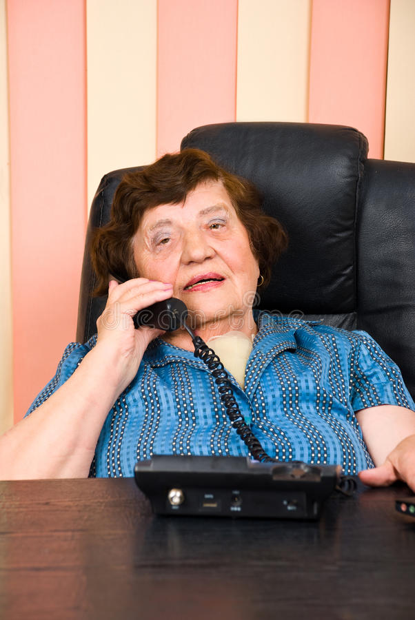 Download Elderly Business Woman Speaking At Telephone Stock Photography - Image: 14702782