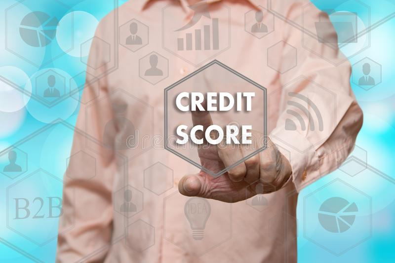 An elderly businessman chooses CREDIT SCORE button on the touch stock images