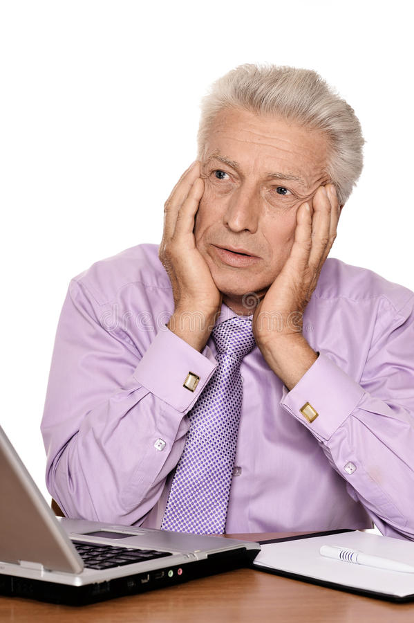 Elderly businessman with laptop stock images