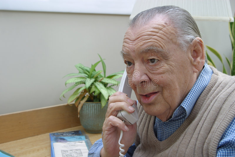 Elderly businessman on telephone stock images